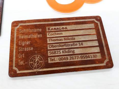 Owner's plate made of mahogany stained wooden boat plywood